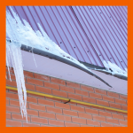 Ice on building roof causing damage